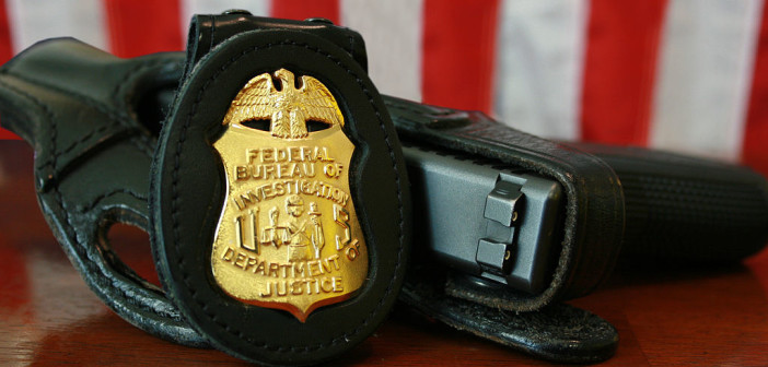 FBI badge and gun (Credit: WIkipedia)